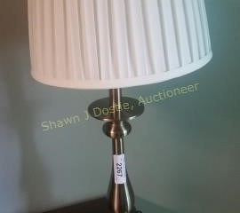 Brushed metal desk lamp room number four building