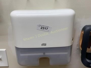 Tork Wall-mounted paper towel dispenser located