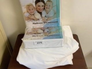 Lot of four mattress pads two new in the package