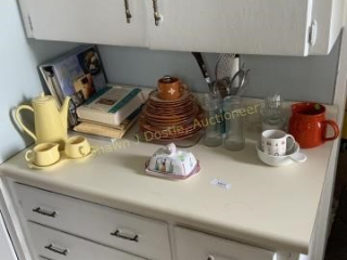Contents of kitchen counter including cream and