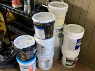 Buckets of paint carpet adhesive and joint