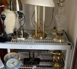 Contents of shelf including lamps in Clocks
