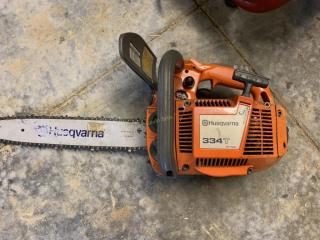 Husqvarna 334T chain saw, runs