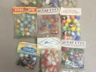 (9) Packs of Unopened Souvenir Marbles