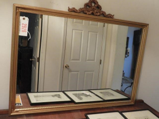 Antique gold framed mirror with decorated floral