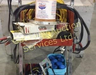 Metal Cart on Wheels has Booster Cables,
