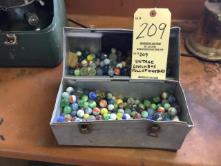 Vintage lunch box full of marbles