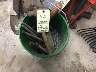Bucket of tools and fence staples