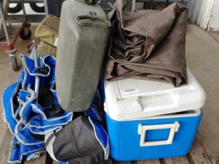 Pallet of assorted camping equipment