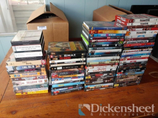 Box of assorted DVD's, VHS's and CD's