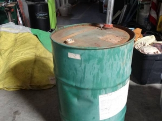 Metal drum w/ contents and pump