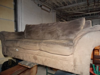 Nice 3 cushion couch. no damage, just needs cleaned.