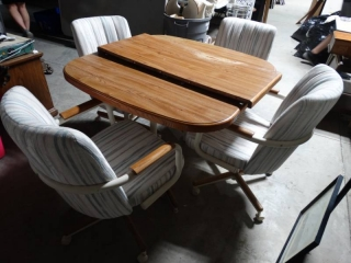 Dining room set- Table w/ 4 arm chairs on wheels & 1 leaf