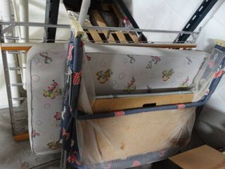 Peterson fold up pin and baby bed with metal and wood frame.