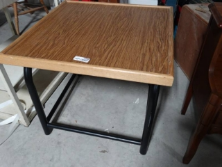 Wooden table with metal base.