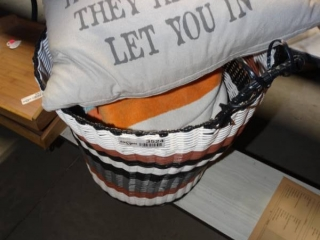 Quote pillows, towels and waste basket.