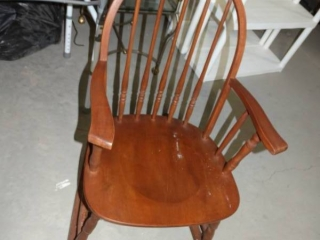 Nice wooden rocking chair.