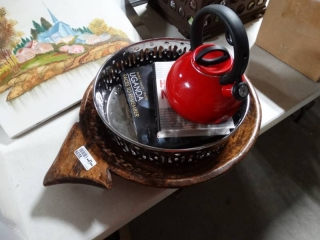 Teapot, metal tray, wood tray and books.