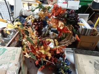 Lot of fake floral arrangements.