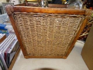 Wicker waste basket and glass vase.