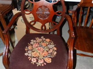 Wooden chair with cushion.