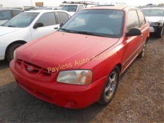 2002 Hyundai Accent KMHCF35G62U210452 Red