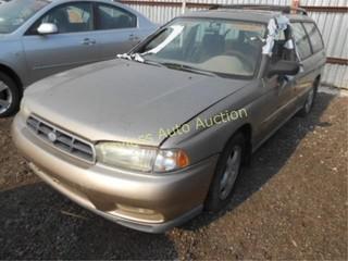 1999 Subaru Legacy 4S3BK4353X7310212 Tan