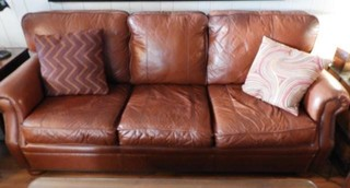4 piece leather living room suite tan in color