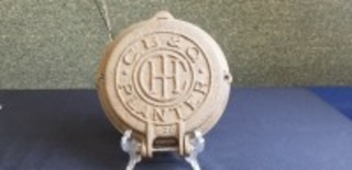 International Harvester C B & Q cast iron planter lid