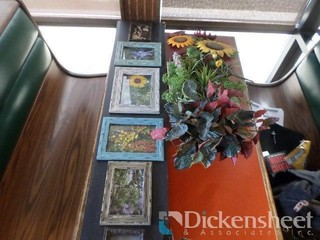 Small framed pictures and artificial flowers