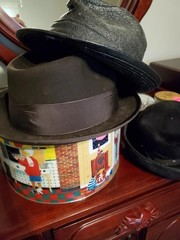 TIN OF MENS HATS