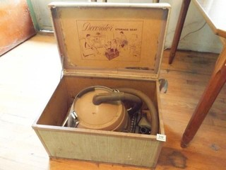 Old Singer Vacuum in Storage Seat