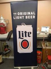 "MILLER LITE - Retractable display banner stand / easy to set up and take down! OR CAN BE HUNG! - LARGE! APPROX 30"" X 80"" - SEE PICTURES!"