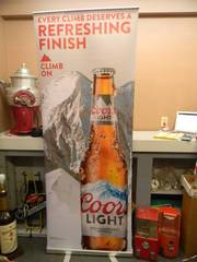 "COOR'S LIGHT - Retractable display banner stand / easy to set up and take down! OR CAN BE HUNG! - LARGE VERY COOL! APPROX 30"" X 80"" - SEE PICTURES!"