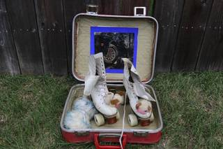 Vintage roller skates and carrying case