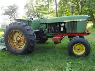 1964 - 1965 John Deere 4020 with Farm Hand F235 Loader and bucket