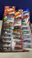 Flat: Apx 24 Assorted Holiday Series Hot Wheels