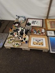 Skid of Cow decor and pictures