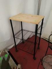 Roll around wire wood top kitchen stand.