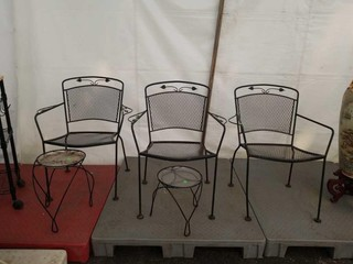 3 outdoor metal chairs and 2 metal plants stands