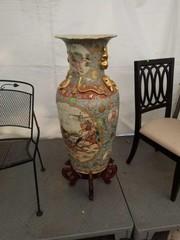 Large oriental vase on stand. Does have damage.