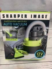 Sharper Image Auto Vacuum (appears new)