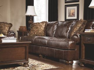Axiom Walnut Sofa MSRP  1899 Beautiful soft leather  Gorgeous on the front  ugly on the back  Wall hugger special