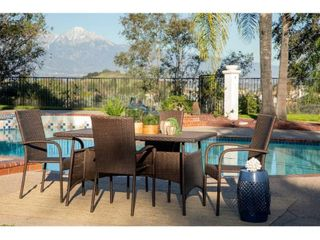 Rhonn Brown and Grey Wicker Outdoor Dining Table only by Havenside Home