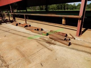 (22+/-) Metal Rollers Near Woodmizer Portable