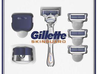 Gillette SkinGuard Men s Razor Holiday Gift Pack including 1 Razor  4 Blades  1 Cap and 1 Stand