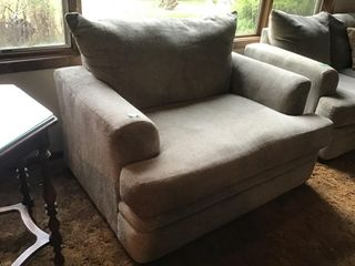 like new overstuffed love seat, tan in color,