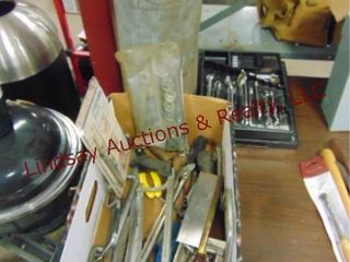 Group of hand tools  saws  wrenches  metal tube