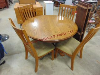 Round 48  table w  4 chairs   2  12  leaves