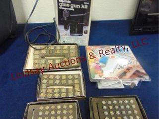 2 hot glue guns   metal stamps